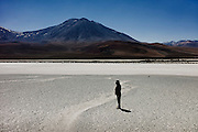 Saturnina Ramos, 76, visits Ojos de San Pedro, a lagoon where she used to live with her community until the lake was dried up by Chuquicamata, a mining company in the 60s. Atacama desert, Chile. August 2010.