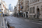 Quiet scene with very few people or vehicles about looking along Fleet Street towards the City of London as the national coronavirus lockdown three continues on 29th January 2021 in London, United Kingdom. Following the surge in cases over the Winter including a new UK variant of Covid-19, this nationwide lockdown advises all citizens to follow the message to stay at home, protect the NHS and save lives.
