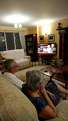 Steve Hogan, 72, and Caroline Hogan, 65, watch a pre-recorded speech by Queen Elizabeth II on television in London, to mark the 75th anniversary of VE Day.