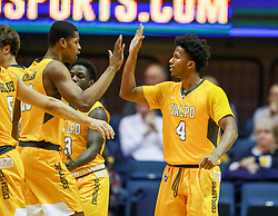 Nov 24, 2018; Morgantown, WV, USA; Valparaiso Crusaders guard Bakari Evelyn (4) celebrates with teammates during the second half against the West Virginia Mountaineers at WVU Coliseum. Mandatory Credit: Ben Queen-USA TODAY Sports