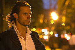 man in New York City at night
