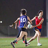 Temasek Poly (red) edged out Ngee Ann Poly (blue) 3-2 in their opening game of the POL-ITE Touch Football Championship. (Photo © Les Tan/Red Sports)