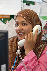 Office worker on the telephone; NHS office UK
