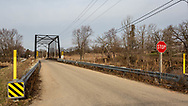 Wisconsin Rustic Road, Dane County, Town of Dunn, Dyreson Road Bridge, 1897 truss bridge of steel, wood and concrete, spanning Yahara River. Photo take morning of March 30, 2021, east approach to one lane bridge.