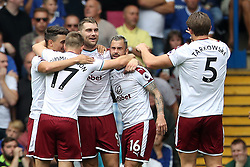 Burnley's Sam Vokes (centre) celebrates scoring his side's first goal of the game during the Premier League match at Stamford Bridge, London.