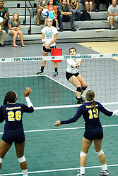 22 September 2015:  Mary Rankin hit ball towards Jacqueline Kibir-Evans and Jennifer Townsend during an NCAA womens division 3 Volleyball match between the Augustana Vikings and the Illinois Wesleyan Titans in Shirk Center, Bloomington IL
