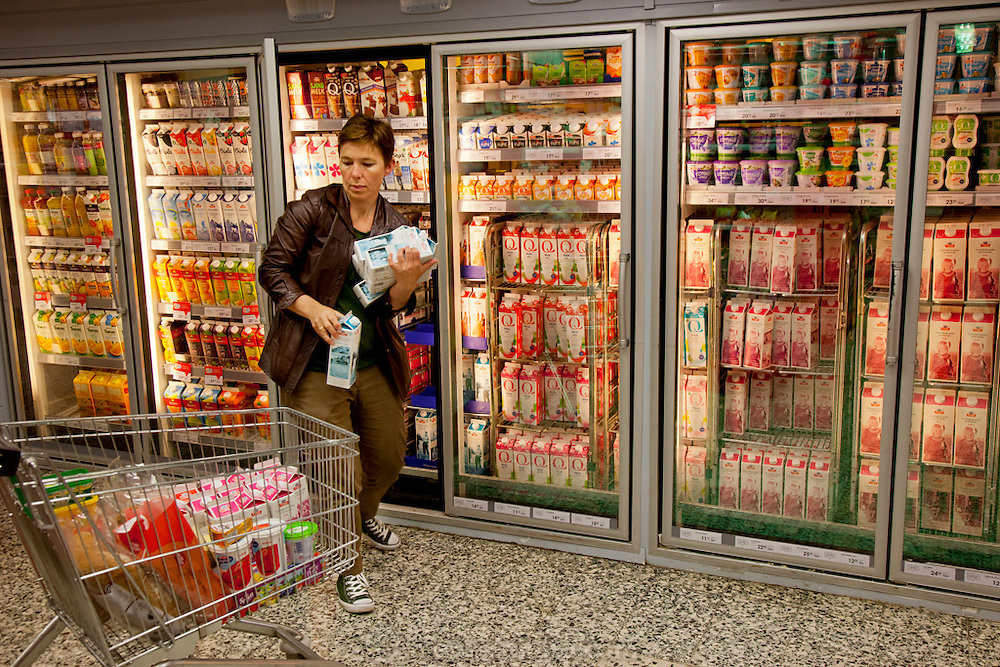 Ottersland Dahl family, of Gjettum, Norway (outside Oslo). Gunhild Valle Ottersland, 45, shopping for weekly groceries. Model-Released.