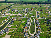 Nederland, Flevoland, Almere Hout, 26-08-2019; Almere Oosterwold, zelfbouw kavels, waarbij de bewoners ook moeten zorgen voor infrastructuur als wegen, energievoorziening, afvalwaterzuivering en waterberging. Men spreekt van doe-het-zelf-gebiedsontwikkeling.<br /> DIY plots, where residents also are responsible for infrastructure such as roads, energy supply, waste water treatment and water storage. So-called do-it-yourself area development.<br /> <br /> luchtfoto (toeslag op standard tarieven);<br /> aerial photo (additional fee required);<br /> copyright foto/photo Siebe Swart