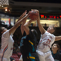 Shiprock Chieftains Evette Lansing (40) and Tanisha Begay (23) block a shot by Navajo Prep Eagle Savannah Anderson (42) Tuesday during the playoff game held in Albuquerque.