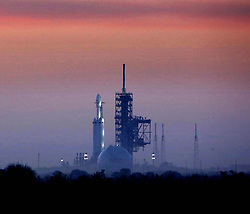 February 6, 2018 - Kennedy Space Center, Florida, U.S. - Enveloped in morning fog, the SpaceX Falcon Heavy sits on launchpad 39A at first light, in this view from Playalinda Beach at the Canaveral National Seashore, just north of the Kennedy Space Center, ahead of the rocket's anticipated launch. Playalinda is one of closest public viewing spots to see the launch, about 3 miles from the SpaceX launchpad. (Credit Image: © Joe Burbank/TNS via ZUMA Wire)