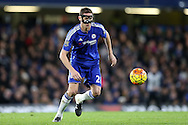 Nemanja Matic of Chelsea wearing a protective face mask in action. Barclays Premier league match, Chelsea v AFC Bournemouth at Stamford Bridge in London on Saturday 5th December 2015.<br /> pic by John Patrick Fletcher, Andrew Orchard sports photography.