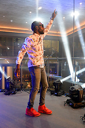 TINIE TEMPAH at a party to celebrate the opening of 'M' a new restaurant & bar at 2 Threadneedle Walk, 60 Threadneedle Street, City of London on 12th November 2014.