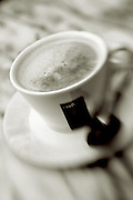 demi tasse sitting on marble table top,cafe con leche,black and white verticle
