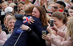 The Duke of Sussex hugs India Brown at the Royal Botanic Gardens in Melbourne on the third day of the royal couple's visit to Australia.