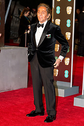 © Licensed to London News Pictures. 18/02/2018. VALENTINO arrives on the red carpet for the EE British Academy Film Awards 2018, held at the Royal Albert Hall, London, UK. Photo credit: Ray Tang/LNP