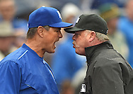 Kansas City Royals bench coach Don Wakamatsu (left) argues with crew chief Jim Joyce (right) after pitcher Kelvin Herrera (not pictured) was throw out of the game against the Oakland Athletics during the eighth inning at Kauffman Stadium.