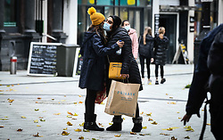 © Licensed to London News Pictures. 23/10/2020. Cardiff, UK. Two shoppers say goodbye to each other in the city centre of Cardiff on the day that the Welsh Goverment's seventeen-day-long, 'Firebreak Lockdown' comes into action to try and control the spread of coronavirus across Wales. Photo credit: Robert Melen/LNP