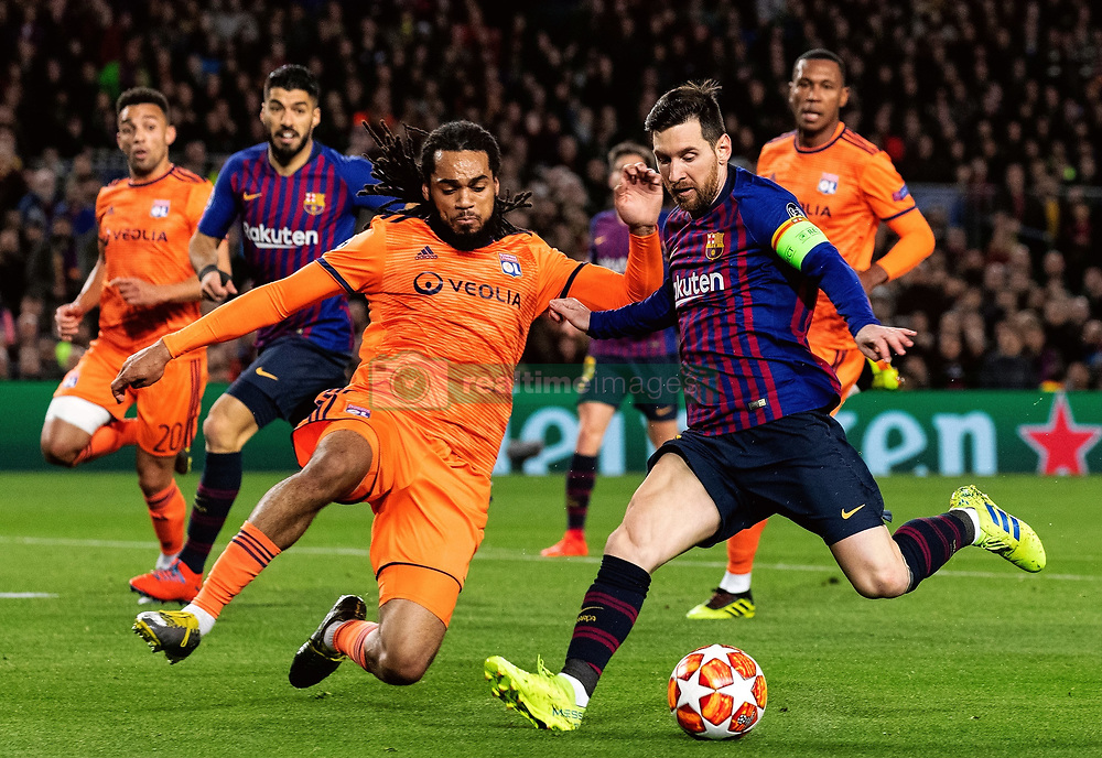 BARCELONA, March 14, 2019  Barcelona's Lionel Messi (Front R) vies with Lyon's Jason Denayer (Front L) during the UEFA Champions League match between Spanish team FC Barcelona and French team Lyon in Barcelona, Spain, on March 13, 2019. Barcelona won 5-1 and advanced to the quarterfinals. (Credit Image: © Joan Gosa/Xinhua via ZUMA Wire)