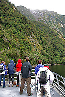 Milford Sound is New Zealand's top tourist destination. It was described by Rudyard Kipling as the Eigth Wonder of the World. Geographically it is not a sound but a fijord. It is 15 kilometres long and its sheer rock interfaces rise to 1200 metres. 201004055027..© Victor Patterson, 54 Dorchester Park, Belfast, N Ireland. Tel: +44 2890661296; Mobile: +44 7802 353836; Emails: victorpatterson@me.com & victorpatterson@gmail.com; www.victorpatterson.com