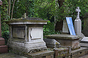 A genealogy society has a stall next to tombs and memorials in Nunhead Cemetery whose deceased occupants were important members of Victorian society from the industrial age. Family history groups are also present to advertise their products during this annual open day, an opportunity for the Friends of the cemetery to celebrate and educate Londoners, old and young - thereby helping to preserve and conserve this historic site.