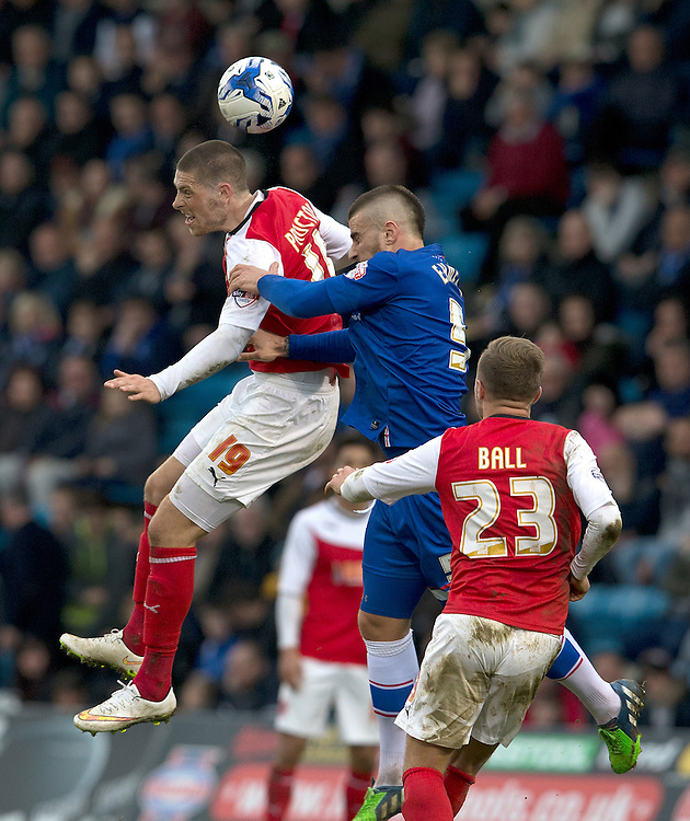 Fleetwood Town's Jamie Proctor wins this aerial battle with Gillingham's Max Ehmer<br /> <br /> Photographer Stephen White/CameraSport<br /> <br /> Football - The Football League Sky Bet League One - Gillingham v Fleetwood Town -  Friday 3rd April 2015 - MEMS Priestfield Stadium - Gillingham<br /> <br /> © CameraSport - 43 Linden Ave. Countesthorpe. Leicester. England. LE8 5PG - Tel: +44 (0) 116 277 4147 - admin@camerasport.com - www.camerasport.com