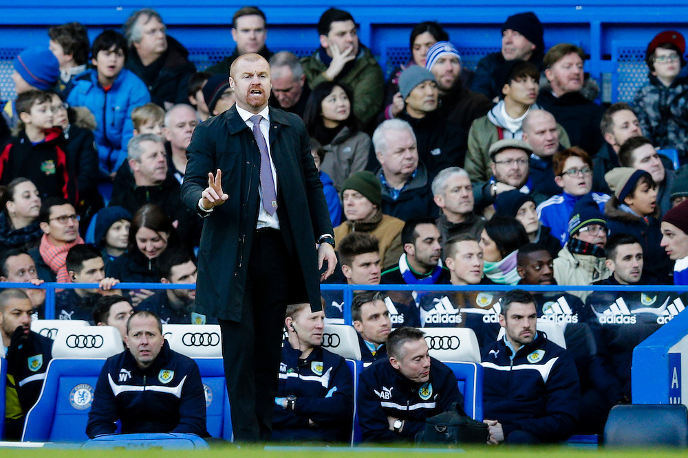 Burnley manager Sean Dyche shouts instructions to his team from the dug-out<br /> <br /> Photographer Craig Mercer/CameraSport<br /> <br /> Football - Barclays Premiership - Chelsea v Burnley - Saturday 21st February 2015 - Stamford Bridge - London<br /> <br /> © CameraSport - 43 Linden Ave. Countesthorpe. Leicester. England. LE8 5PG - Tel: +44 (0) 116 277 4147 - admin@camerasport.com - www.camerasport.com