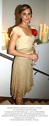 Model YASMIN LE BON at a party in London on 12th March 2003.	PHY 283