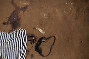 The dead body of a man killed during one of the latest incidents of sectarian violence is pictured on the ground in the district of Combattant near the airport of the capital Bangui January 29, 2014.