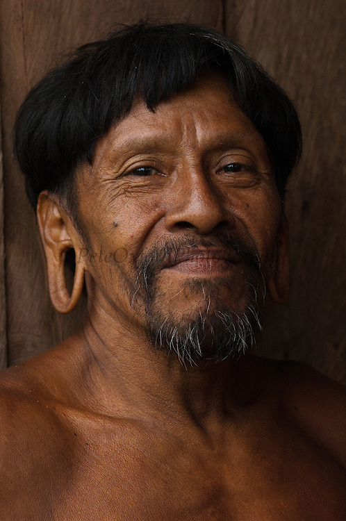 Huaorani man, Meñewa Wane.<br /> Bameno Community. Yasuni National Park.<br /> Amazon rainforest, ECUADOR.  South America<br /> This Indian tribe were basically uncontacted until 1956 when missionaries from the Summer Institute of Linguistics made contact with them. However there are still some groups from the tribe that remain uncontacted.  They are known as the Tagaeri & Taromenane. Traditionally these Indians were very hostile and killed many people who tried to enter into their territory. Their territory is in the Yasuni National Park which is now also being exploited for oil.