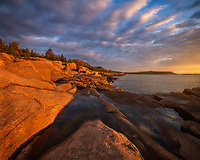 Dramatic sunrise on the coast of Maine in Acadia National Park.
