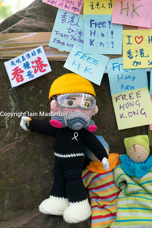 Edinburgh, Scotland, UK. 12 June 2021. A pro democracy rally was held this afternoon on The Meadows in Edinburgh by Hong Kong people resident in Scotland. Protesting against draconian anti-democracy laws imposed on Hong Kong by Beijing. The protesters were a mix of long term residents, students and recent arrivals who have taken advantage of the UK government's special visa scheme to allow Hong Kong residents to emigrate to the UK. Pic; A Lennon Wall was created from any pro democracy messages. These are now illegal in Hong Kong. Iain Masterton/Alamy Live News