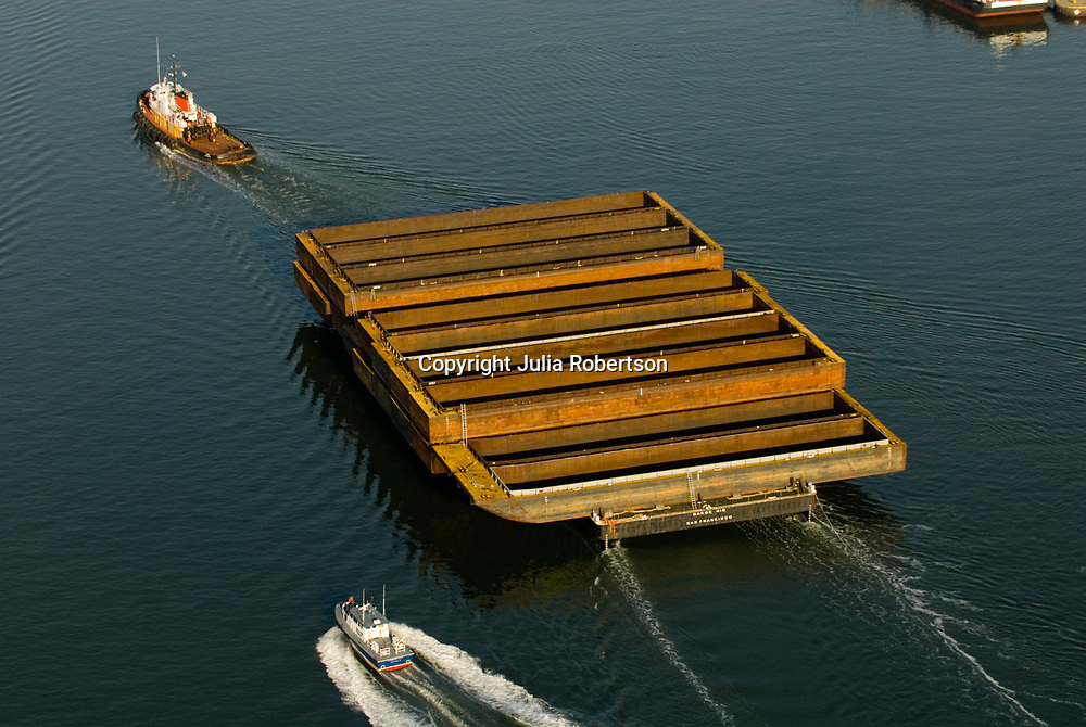 aerial view of Crowley Tug Boat Ranger and 17 barges with Pilot boat in New York Harbor