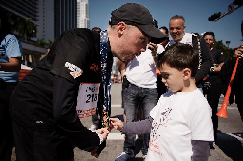 Maickel's nephew, touches the medal after completing the ING Miami Half Marathon. January 30th, 2011.