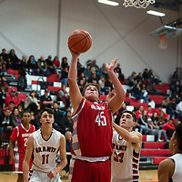 Michael Maes (45) for Bernalillo takes a shot under the basket in their game against Grants Tuesday, Dec. 11, at Grants High School. Bernalillo won 59-41.