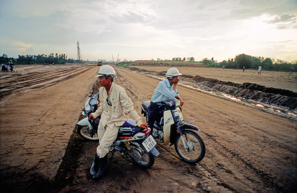 Vietnamese workers rest in the evening at a development project site in Ho Chi Minh City Vietnam. 2007.