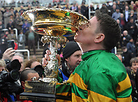 National Hunt Horse Racing - 2020 Cheltenham Festival - Tuesday, Day One (Champion Day)<br /> <br /> Winner, Barry Geraghty on Epatante kisses the trophy, in the 15.30 Unibet Champion hurdle challenge trophy ( Class 1), at Cheltenham Racecourse.<br /> <br /> COLORSPORT/ANDREW COWIE