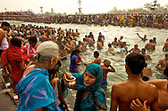 Ablutions, worship and rituals carry on along the riverbanks. The Kalsaha, a metal pot, is filled with water to represent the life giving ability of nature.