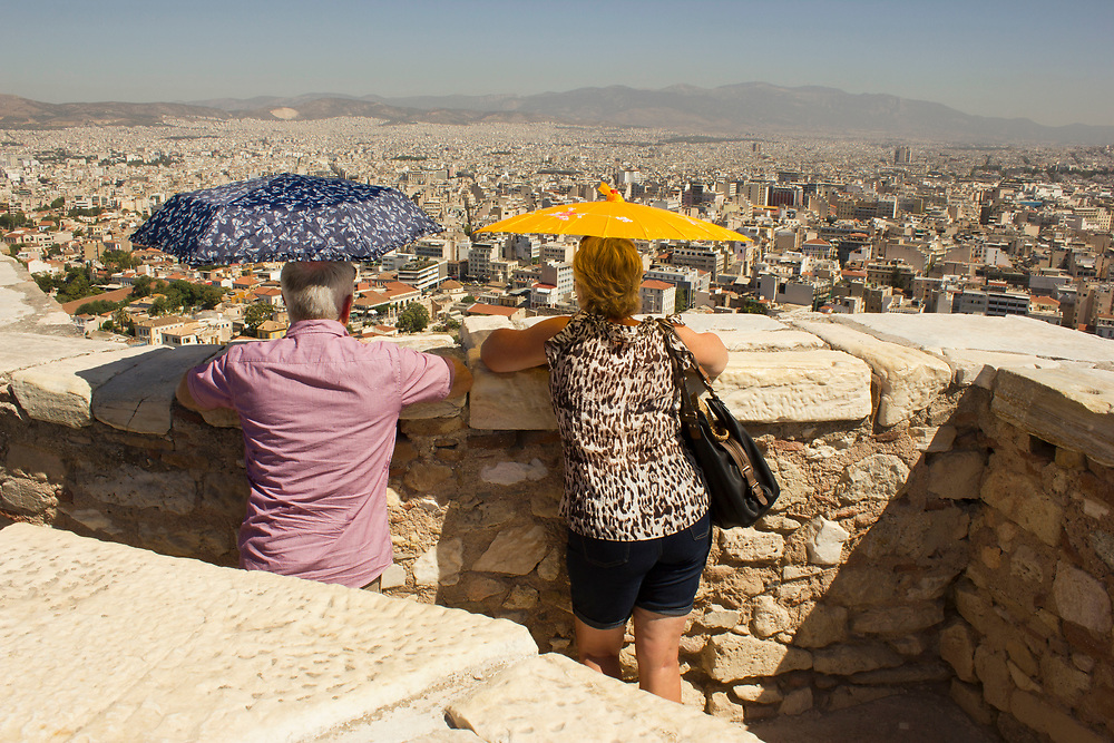 Couple looking at the City from the  Acropolis Parthenon, Athens, Greece.Dog, New Mexico, USA