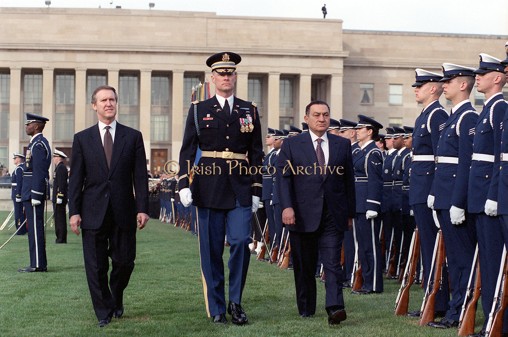 Secretary of Defense William S. Cohen (left) joins Lt. Col. Charles Sniffin (center), U.S. Army, the commander of troops, in escorting visiting Egyptian President Hosni Mubarak (right) as he inspects the joint services honor guard during a March 30, 2000, ceremony welcoming him to the Pentagon.
