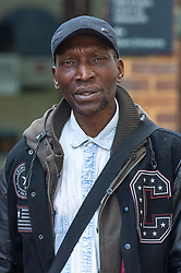 © Licensed to London News Pictures. 16/03/2020. London, UK. Shaffick Brimer stands outside Isleworth Crown Court. Mr Brimer is accused of dishonestly claiming he lived at Grenfell Tower to claim cash and accommodation. Mr Brimer faces one charge of fraud by false representation. He is the 20th person to be charged with fraud in relation to the Grenfell Tower. Photo credit: Peter Manning/LNP