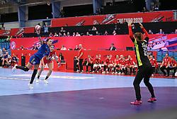 KOLDING, DENMARK - DECEMBER 5: Cristina Neagu shoots a 7m penalty at Poland's Weronika Gawlik during the EHF Euro 2020 Group D match between Poland and Romania in Sydbank Arena, Kolding, Denmark on December 5, 2020. Photo Credit: Allan Jensen/EVENTMEDIA.