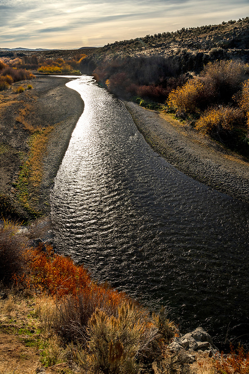 Open Edition Numbered Prints<br /> The Wood River just before it enters Magic Reservoir with fall colors and streaking clouds in south central Idaho