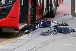 © Licensed to London News Pictures. 11/08/2019. London, UK. Blood stained clothing at the bus stop on the Seven Sisters Road junction with St Ann's Road in Tottenham, north London, where a 25 year old man was found with multiple stab wounds on Bus 67 at the Seven Sister Road/Kerswell Close bus stop, just before 2.20pm. According to the Met police, the victim is fighting for his life in hospital. Photo credit: Dinendra Haria/LNP