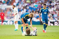 Real Madrid's player Luka Modric and Celta de Vigo's player Daniel Wass during a match of La Liga Santander at Santiago Bernabeu Stadium in Madrid. August 27, Spain. 2016. (ALTERPHOTOS/BorjaB.Hojas)
