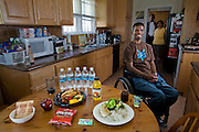 Felipe Adams, a 30-year-old Iraq war veteran, with his parents and his typical day's worth of food at their home in Inglewood, California.  (From the book What I Eat: Around the World in 80 Diets.) The caloric value of his day's worth of food on a day in the month of September was 2100 kcals. He is 30 years of age; 5 feet 10 inches tall; and 135 pounds. Adams was paralyzed by a sniper's bullet while serving in Baghdad, Iraq. Damaged nerves that normally enervate a missing or paralyzed body part can trigger the body's most basic warning that something isn't right: pain. Felipe experiences these phantom pains, which feel like stabbing electric shocks, dozens of times a day; they cause him to grip his leg tightly for a moment or two until the sensation subsides.