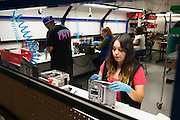 An employee works on refurbishing a Super Nintendo at the GameStop retro classics console games refurbishment center in Grapevine, Texas on June 24, 2015. (Cooper Neill for Mashable)