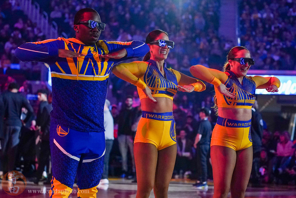 February 23, 2020; San Francisco, California, USA; Golden State Warriors Dance Team dancers Jermaine, Helen, and Lizzie during the first quarter against the New Orleans Pelicans at Chase Center.