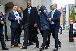 © Licensed to London News Pictures. 21/10/2016. London, UK. Former News of the World journalist MAHZER MAHMOOD (hooded top) walks past former actor JOHN ALFORD (far left) as he arrives at The Central Criminal Court in London to be sentenced for perverting the course of justice. Former London's Burning actor JOHN ALFORD was the victim of a sting operation by MAHZER MAHMOOD. Photo credit: Tolga Akmen/LNP