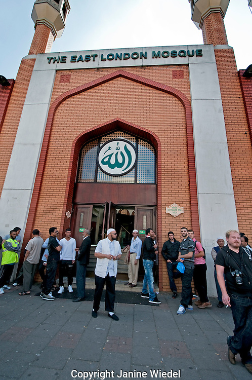 East London Mosque with people leaving after a service