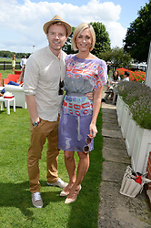 Left to right, JENNI FALCONER and JAMES MIDGLEY at the Audi International Polo at Guards Polo Windsor Great Park, Egham, Surrey on 28th July 2013.